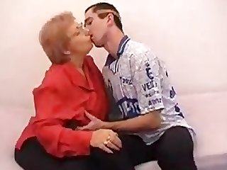 Chubby Mature fucks a guy with funny..