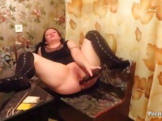 mature lady fucks her holes with a..