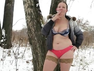 smoke in the winter in the woods in his..